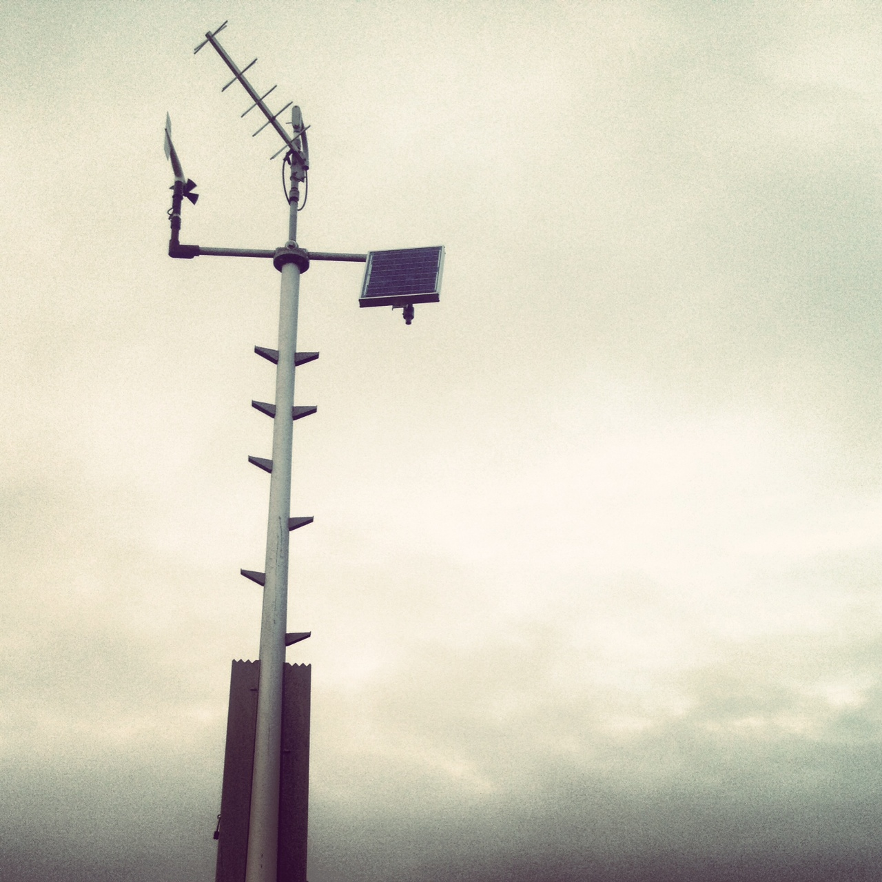 A lonely weather station located amid a turbulent sky